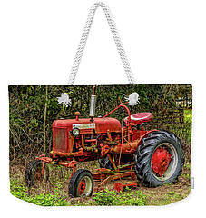 Weekender Tote Bag featuring the photograph Farmall Cub by Christopher Holmes