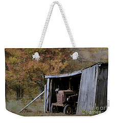 Weekender Tote Bag featuring the photograph Farmall Tucked Away by Benanne Stiens