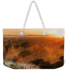 Weekender Tote Bag featuring the photograph Farmer Returning To Village In The Evening by Pradeep Raja Prints