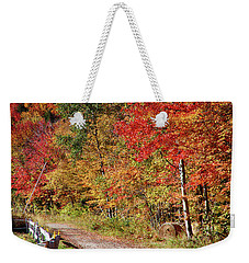 Weekender Tote Bag featuring the photograph Farmers Path Of Fall Colors by Jeff Folger