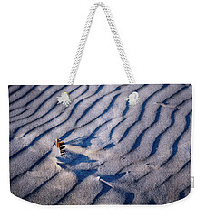 Weekender Tote Bag featuring the photograph Feather In Sand by Michelle Calkins
