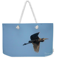 Weekender Tote Bag featuring the photograph Feathering The Nest by David Bearden