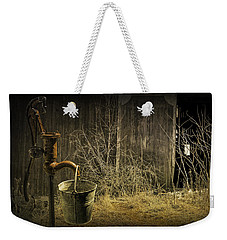 Fetching Water From The Old Pump Weekender Tote Bag by Randall Nyhof
