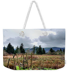 Weekender Tote Bag featuring the photograph Field, Clouds, Distant Foggy Hills by Chriss Pagani