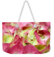 Weekender Tote Bag featuring the photograph Field Of Petals by Corinne Rhode