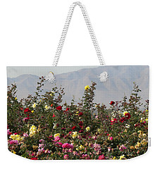 Weekender Tote Bag featuring the photograph Field Of Roses by Laurel Powell
