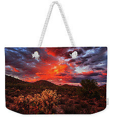 Weekender Tote Bag featuring the photograph Fierce Beauty by Rick Furmanek