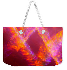 Weekender Tote Bag featuring the photograph Fiery Cyclonic Fury by Greg Collins