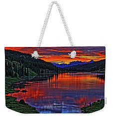 Weekender Tote Bag featuring the photograph Fiery Lake by Scott Mahon