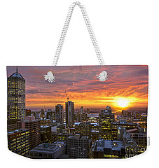 Weekender Tote Bag featuring the photograph Fiery Sunset by Ray Warren