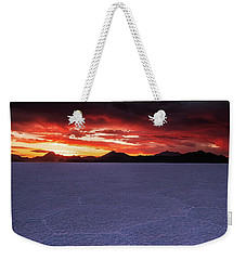 Weekender Tote Bag featuring the photograph Fight For The Light by Edgars Erglis