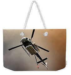 Weekender Tote Bag featuring the photograph Fire Drop by Chris Tarpening