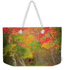 Weekender Tote Bag featuring the photograph Fire Red Path  by Emmanuel Panagiotakis
