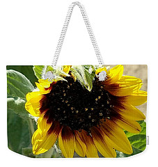 Weekender Tote Bag featuring the photograph First Bloom Maturing  by Angela J Wright