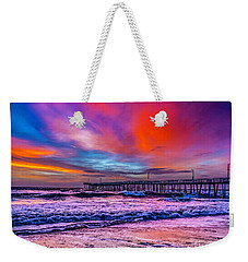 Weekender Tote Bag featuring the photograph First Light On The Beach by Nick Zelinsky