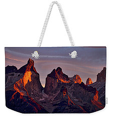 First Light On The Cuernos - Patagonia Weekender Tote Bag by Stuart Litoff