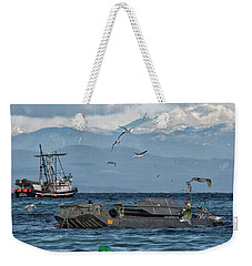 Weekender Tote Bag featuring the photograph Fish Are Flying by Randy Hall