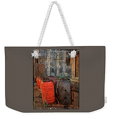 Weekender Tote Bag featuring the photograph Fish Barrels by Thom Zehrfeld