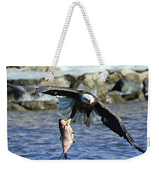 Weekender Tote Bag featuring the photograph Fish In Hand by Coby Cooper