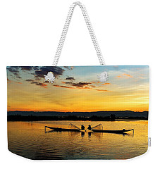 Weekender Tote Bag featuring the photograph Fisherman On Their Boat by Pradeep Raja Prints