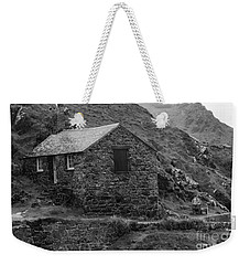 Weekender Tote Bag featuring the photograph Fishermans Net Shed by Brian Roscorla