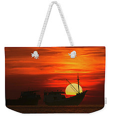 Weekender Tote Bag featuring the photograph Fishing Boats In Sea by Pradeep Raja Prints
