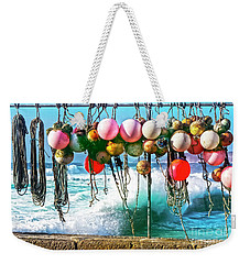 Weekender Tote Bag featuring the photograph Fishing Buoys by Terri Waters