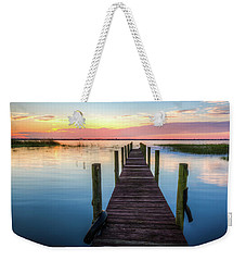 Weekender Tote Bag featuring the photograph Fishing Dock At Sunrise by Debra and Dave Vanderlaan