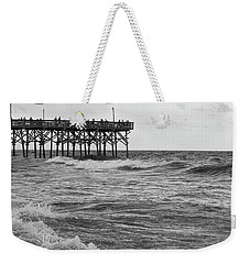 Weekender Tote Bag featuring the photograph Fishing Off The Pier At Myrtle Beach by Chris Flees