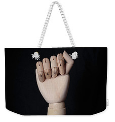 Weekender Tote Bag featuring the photograph Fist by Edward Fielding