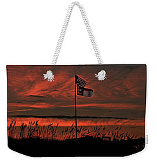 Weekender Tote Bag featuring the photograph Flags And Sea Oats by John Harding
