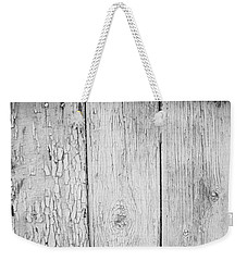 Weekender Tote Bag featuring the photograph Flaking Grey Wood Paint by John Williams