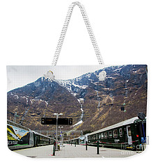 Weekender Tote Bag featuring the photograph Flam Station by Suzanne Luft