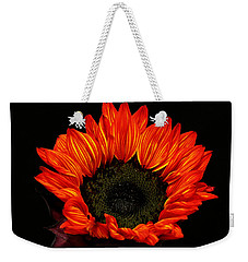 Weekender Tote Bag featuring the photograph Flaming Flower by Judy Vincent