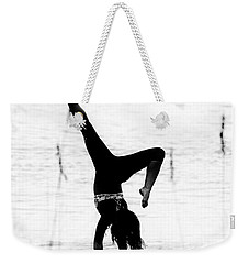 Weekender Tote Bag featuring the photograph Flexible by Alan Raasch