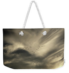 Weekender Tote Bag featuring the photograph Flight 016 Westbound by Robert Geary