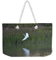 Weekender Tote Bag featuring the photograph Flight by Carol  Bradley