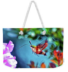 Weekender Tote Bag featuring the photograph Flight Of Mystery - Hummingbird Moth by Kerri Farley