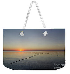 Weekender Tote Bag featuring the photograph Floating Fishnet by Kennerth and Birgitta Kullman