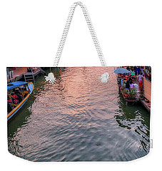 Weekender Tote Bag featuring the photograph Floating Market Sunset by Adrian Evans