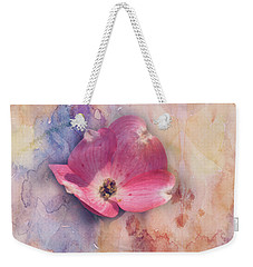 Weekender Tote Bag featuring the photograph Floating Pink Bloom by Toni Hopper