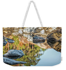 Weekender Tote Bag featuring the photograph Floating Rocks by James Barber
