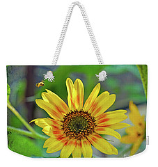 Weekender Tote Bag featuring the photograph Flower Of The Sun by Kerri Farley