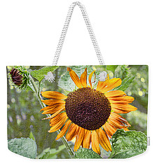 Weekender Tote Bag featuring the photograph Flower Of The Sun by Larry Bishop