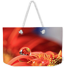 Flower Reflection In Water Drop Weekender Tote Bag by Angela Murdock