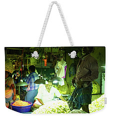 Weekender Tote Bag featuring the photograph Flower Stalls Market Chennai India by Mike Reid