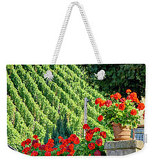 Weekender Tote Bag featuring the photograph Flowers And Vines by Alan Toepfer