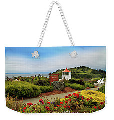 Weekender Tote Bag featuring the photograph Flowers At The Trinidad Lighthouse by James Eddy