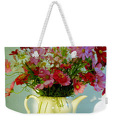 Weekender Tote Bag featuring the photograph Flowers In A Teapot by Patricia Greer
