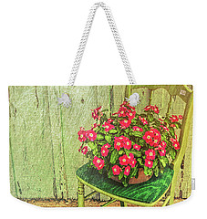 Weekender Tote Bag featuring the photograph Flowers On Green Chair by Lewis Mann